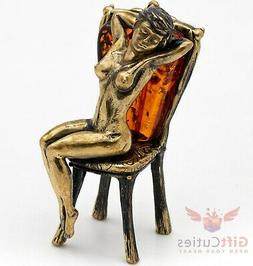Solid Brass Amber Figurine of naked woman relaxing on the ch